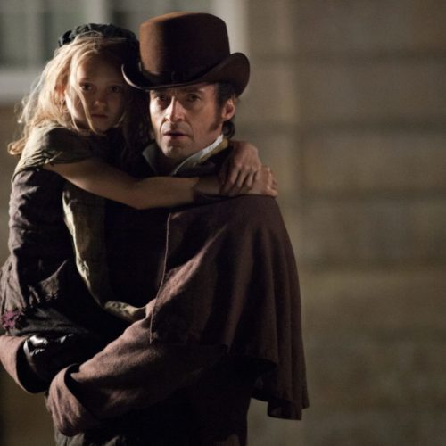 Hugh Jackman as Jean Valjean and Isabelle Allen as Young Cosette
